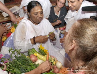 Amma inspects Turtle Barn produce